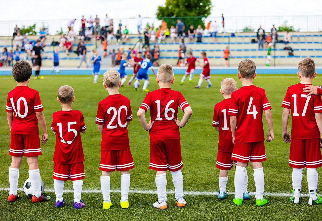 Kids Standing Soccer Field