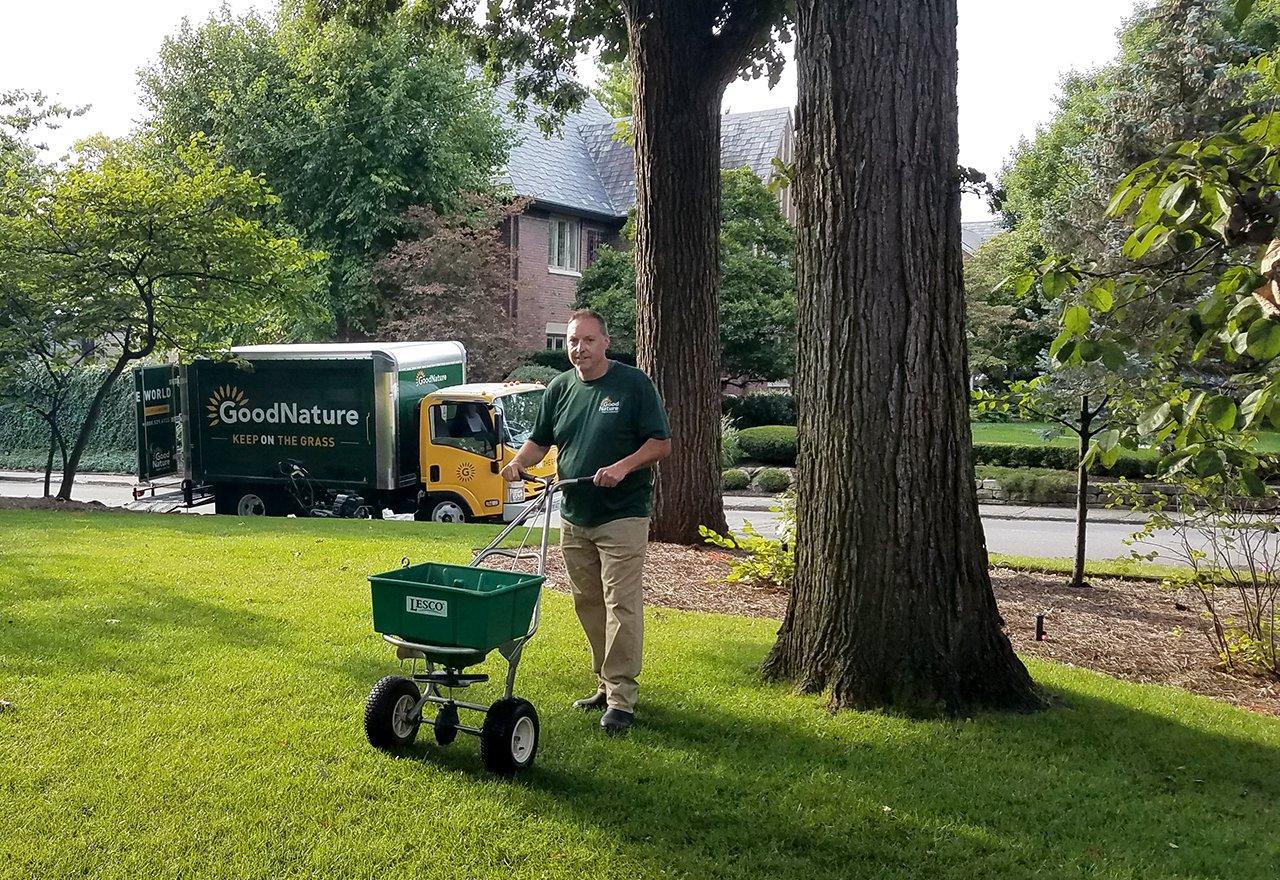 Technician Ed Spreading Seed Lawn